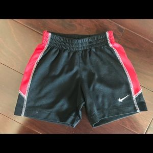 Nike jersey shorts, black/red, size 2T